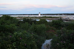 Edgartown lighthouse from a distance 2. Edgartown white lighthouse at sunset from a distance Royalty Free Stock Images