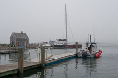 Foggy afternoon at Edgartown harbor, MA. Edgartown, MA - June 20, 2010: Foggy afternoon at Edgartown harbor on Martha's Vineyard Royalty Free Stock Images