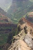 The Edge. Of the rock with a rainy view of Waimea Canyon on Kauai island, Hawaii stock photography