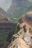 The Edge. Of the rock with a rainy view of Waimea Canyon on Kauai island, Hawaii Stock Photography
