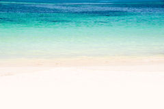 Edge of a beach with turquoise water Royalty Free Stock Photos