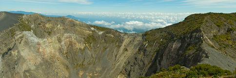 Edge of the Caldera. At an altitude of 11,300 feet, the Irazú Volcano rises above the clouds. The National Park in Costa Rica is home to an inactive volcano Stock Images