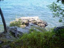 Edge of a Cliff at Cave Point on Lake Michigan royalty free stock photography