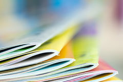 Edge of colorful magazine stacking Stock Images