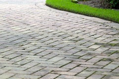 Edge of curved paved driveway Stock Photos
