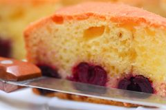 Edge of knife and piece of cherry pie Royalty Free Stock Photography