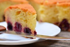 Edge of knife and piece of cherry pie Royalty Free Stock Images