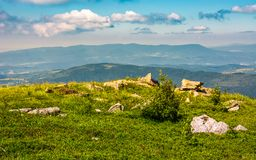 Edge of the mountain hill with boulders. Lovely summertime scenery stock photos
