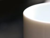 Edge of a mug. Edge of a white mug Royalty Free Stock Photography