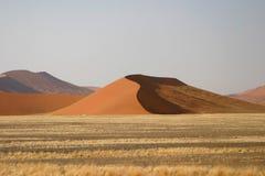 Edge of Namob desert. Scenic landscape of sand dunes on Edge of Namib desert with grass fields in foreground, Sossusvlei, Namibia stock photos
