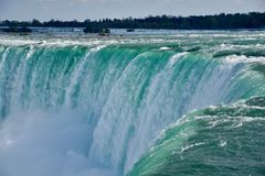 Up close to Niagara Falls. At the edge of the Niagara River torrent as it plunges over the brim of the Horseshoe Falls. It`s spectacular and exhilarating to be stock photos