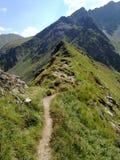 Edge path on mountain peaks Stock Photo