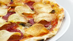Edge of pizza with chips and salami stock video footage