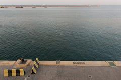 Edge of quay. Dander of falling. Stock Photo