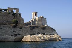 Fortress with a tower on the beach. On the edge of the rock there is a fortress. In the fortress there is a tower. The fortress protects the entrance to the bay stock photo