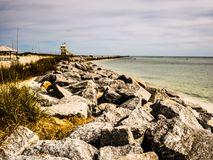 The edge of the rocky ocean. Photo taken near Ponce Inlet, Florida, U.S.A .; Winter 2016. Only a part of the beach that were rocky stock images