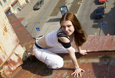 On edge of a roof. The beautiful girl on edge of a roof Stock Photos