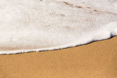 Edge of sea and surf on sandy beach Stock Photography