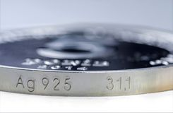 Edge of a silver coin of assay mark 925. Sterling silver coin. Edge of a silver coin of assay mark 925. Selective focus royalty free stock photography