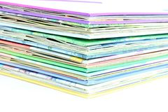 Edge of the stack of colored paper Stock Photos