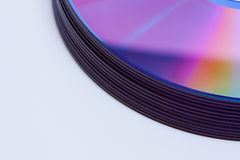 Edge of a stack of reflective CD/DVD Stock Images