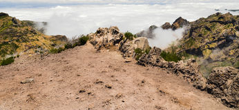 Edge of steep, being above clouds, in the mountains of Madeira Stock Image