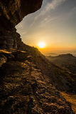 On the Edge. Sunset on the edge of a cliff in the Torcal de Antequera, Málaga, Spain Stock Photo