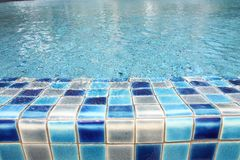 Edge of swimming pool Royalty Free Stock Image