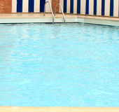 Edge of a swimming pool. In a hot day Royalty Free Stock Image