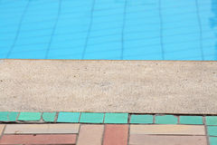 Edge of a swimming pool. In a hot day Stock Photography