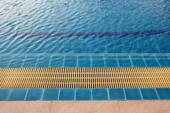 The edge of swimming pool. With blue water Stock Photos