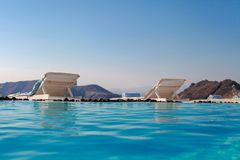 Edge of swimming pool on the cliff of Santorini Royalty Free Stock Image