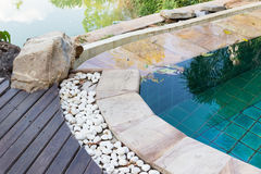 Edge of the swimming pool decorating with white stone Stock Photos