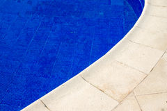 Edge of a swimming pool Stock Images