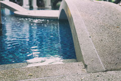 Edge of swimming pool in hotel resort Royalty Free Stock Image