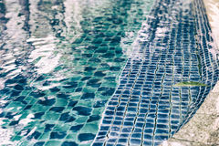 Edge of swimming pool in hotel resort Royalty Free Stock Images