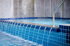 Edge of the swimming pool overflow Stock Image