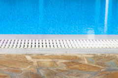 Edge of the swimming pool overflow Stock Photography