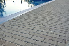 Edge Of Swimming Pool With Reflection And Concrete Paving Royalty Free Stock Photos