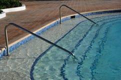 Edge of swimming pool Royalty Free Stock Image