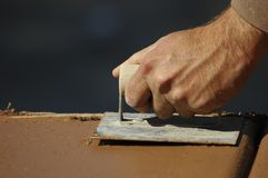 Edge Trowel. Putting radius on a concrete slab with an edging trowel Stock Image