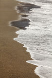 The edge of the waves at the beach Stock Photography