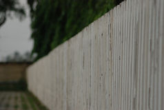 Edge of white fence Stock Photo