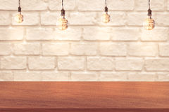 Edge of wood table and brick wall background Stock Photo