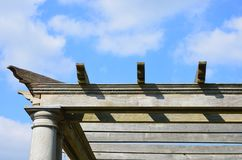 Edge of wooden pergola with sky Royalty Free Stock Image