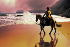 At the edge of the World. Cowboy and his horse, arriving at the edge of the Earth and discovering the immensity of the ocean Stock Photo