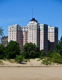 Edgewater Beach Apartments. This is a Spring picture of the iconic Edgewater Beach Apartment from Hollywood Beach on Lake Michigan in Chicago, Illinois.  The Stock Photo