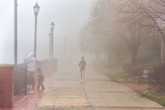 EDGEWATER, NEW JERSEY - JANUARY 11, 2014: Woman Running in Misty January Morning Royalty Free Stock Photography