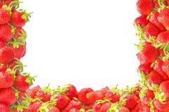 Edging or frame with fresh red summer fruits strawberries isolated on white background. Natural decoration for design.  Royalty Free Stock Photography