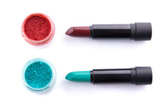 Edgy color lipsticks with matching eye shadows Royalty Free Stock Photos